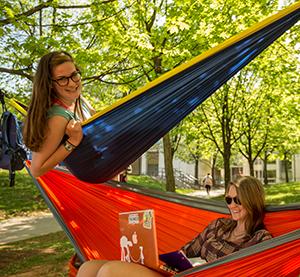 Two female students relaxing in hammocks