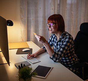 Student at computer smiling